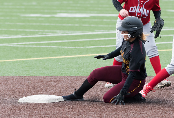 04/29/19 Wesley Bunnell | Staff New Britain softball defeated Conard at Chesley Park on Monday afternoon. Amanda Jacobs slides into second base.