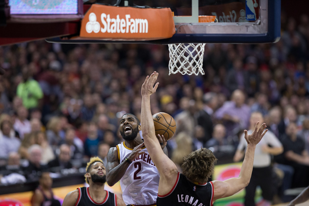 . Michael Johnson - The News-Herald Kyrie Irving (2) of the Cleveland Cavaliers goes up for a layup against Meyers Leonard during a home game against the Portland Trailblazers on November 23, 2016 at the Quicken Loans Arena.