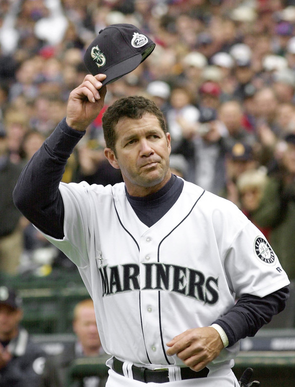 . EDGAR MARTINEZ -- Seattle Mariners\' Edgar Martinez tips his cap to the crowd as he is introduced on opening day against the Chicago White Sox on April 1, 2002, in Seattle. Martinez hit a 2-RBI single in the eighth. The White Sox won, 6-5. (AP Photo/Elaine Thompson)