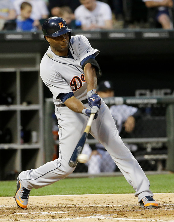 . Detroit Tigers\' Torii Hunter hits a single against the Chicago White Sox during the fifth inning of a baseball game in Chicago on Thursday, June 12, 2014. (AP Photo/Nam Y. Huh)