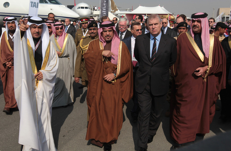 . Bahraini Crown Prince Salman bin Hamad Al Khalifa, front row third right, tours the Bahrain International Airshow with British Prince Andrew, Duke of York, second right, and Bahraini Prince Abdullah bin Hamad Al Khalifa, right, on Thursday, Jan. 16, 2014, in Sakhir, Bahrain. Bahrain\'s state news agency said the International Airshow opened to announcements of more than $3 billion in agreements. (AP Photo/Hasan Jamali)