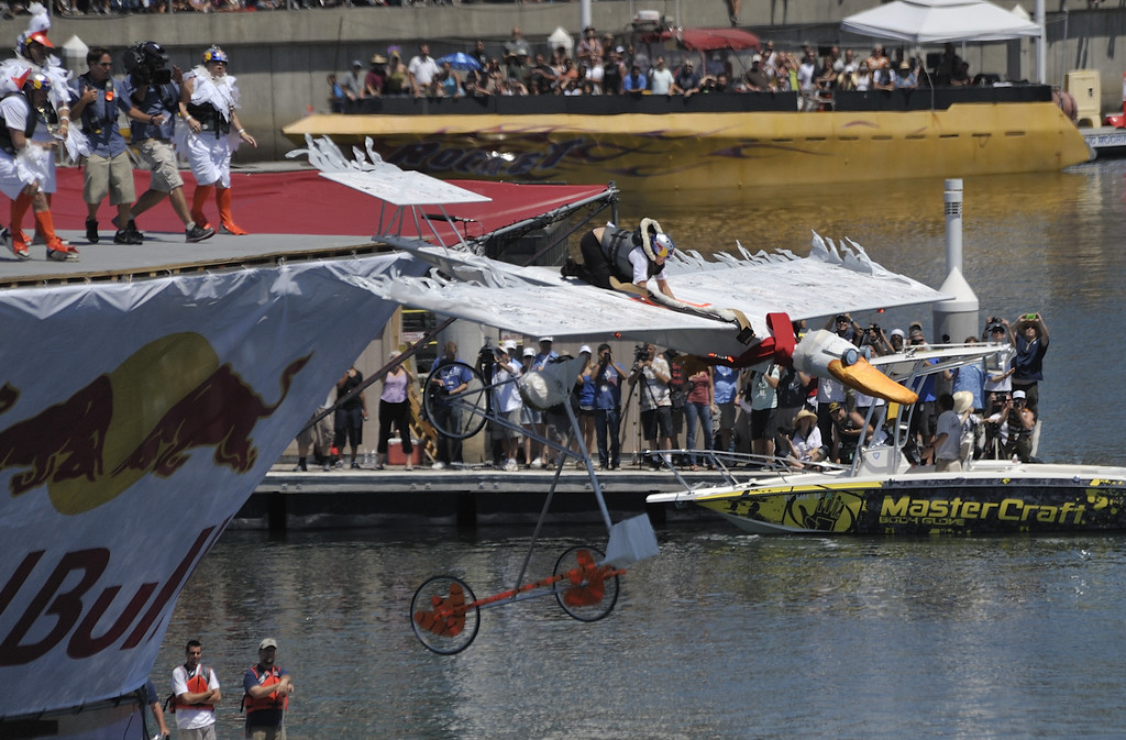 """. LONG BEACH, CALIF. USA -- Amber Cowan pilots \""""The Flight of the Spruce Goose 2.0\"""" during the Flugtag in Rainbow Harbor in Long Beach, Calif. on August 21, 2010. Thirty five teams competed in the Red Bull event where teams build homemade, human-powered flying machines and pilot them off a 30-foot high deck in hopes of achieving flight.  Flugtag means \""""flying day\"""" in German. They are on distance, creativity and showmanship..Photo by Jeff Gritchen / Long Beach Press-Telegram.."""
