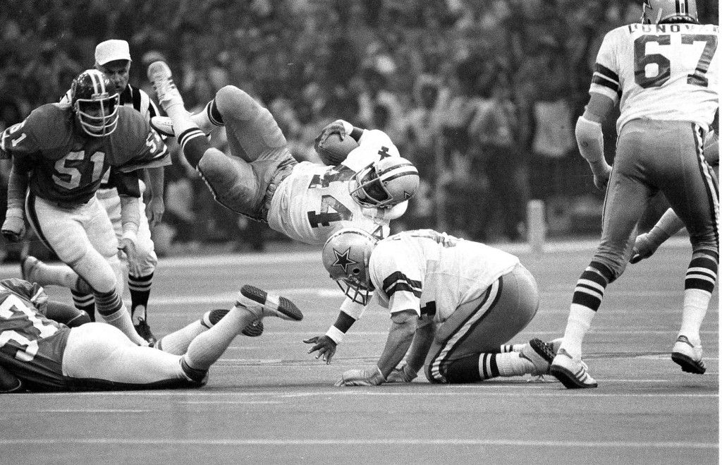 . Dallas running back Robert Newhouse (44) is tripped up after a short gain during Super Bowl XII in New Orleans. Denver linebacker Bob Swenson (51) is shown. (AP Photo)