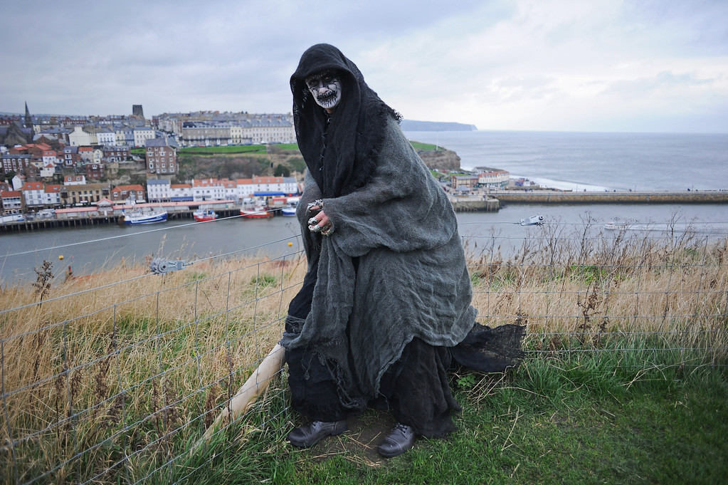 . WHITBY, ENGLAND - NOVEMBER 02: Steve Price, a construction worker from Chesterfield, comes dressed as the \'Reaper\' to the Goth weekend on November 2, 2013 in Whitby, England. The Whitby Gothic Weekend that takes place in the Yorkshire seaside town twice yearly in Spring and Autumn started in 1994 and sees thousands of extravagantly dressed followers of Victoriana, Steampunk, Cybergoth and Romanticism visit to take part in celebrating Gothic culture.  (Photo by Ian Forsyth/Getty Images)