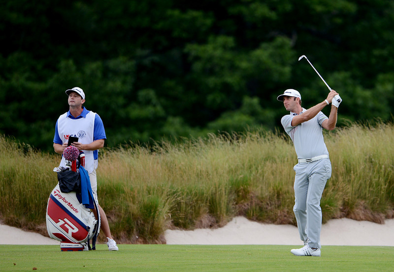 . Dustin Johnson of the United States hits his second shot on the 14th hole during Round One of the 113th U.S. Open at Merion Golf Club on June 13, 2013 in Ardmore, Pennsylvania.  (Photo by David Cannon/Getty Images)