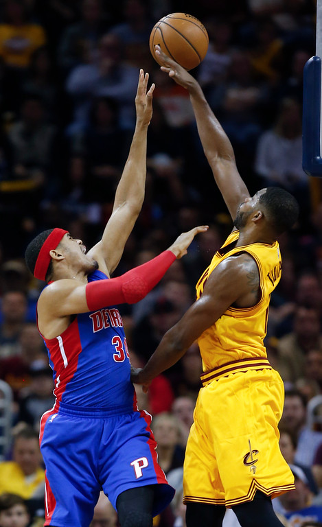. Detroit Pistons\' Tobias Harris, left, shoots over Cleveland Cavaliers\' Tristan Thompson during the first half of an NBA basketball game Friday, Nov. 18, 2016, in Cleveland. (AP Photo/Ron Schwane)