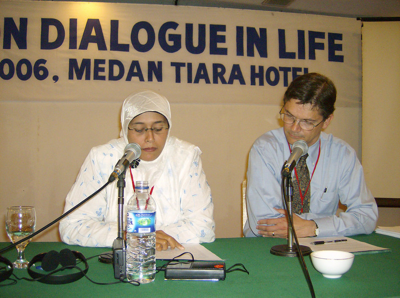 Syarifah Rahmah (left) and the Rev. Mark N. Swanson read a draft  statement members of the dialogue issued June 30.  Rahmah was a Muslim member of the dialogue from Aceh, Indonesia.  Swanson, an ELCA pastor,  was director of the Islamic Studies Program at Luther Seminary, St. Paul,  Minn.