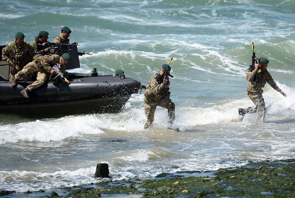 . British Royal Marine Commandos demonstrate a beach landing during D-Day commemorations in Portsmouth in southern England on June 5, 2014. Several hundred surviving veterans of the 1944 D-Day landings are commemorating the 70th anniversary of the mission on both sides of the English channel.  AFP PHOTO / CARL COURT/AFP/Getty Images