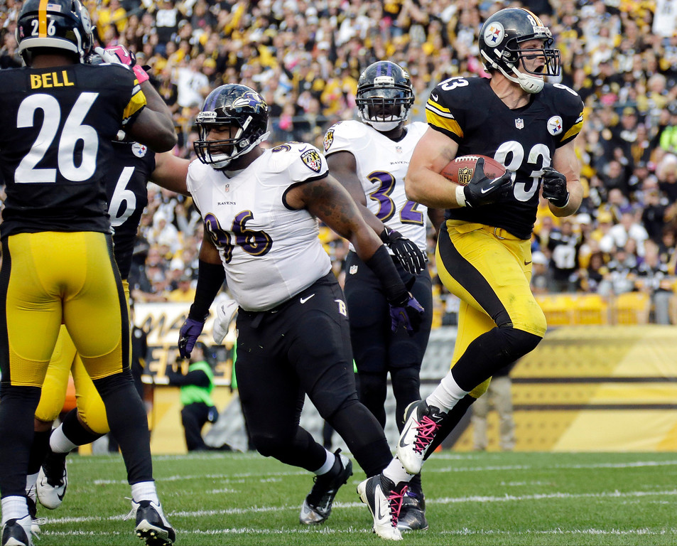 . Pittsburgh Steelers tight end Heath Miller, right, gets into the end zone past Baltimore Ravens defensive end Marcus Spears (96) for a touchdown in the first quarter of an NFL football game in Pittsburgh on Sunday, Oct 20, 2013. (AP Photo/Gene J. Puskar)