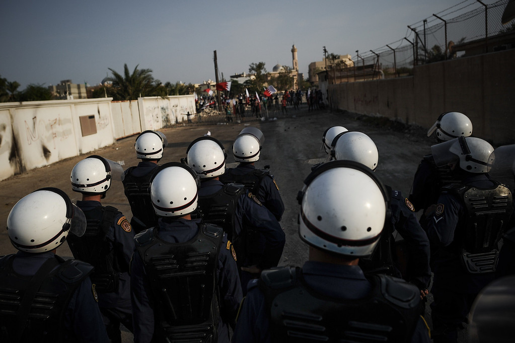 . Bahraini riot police stand guard during a demonstration against the ruling regime in the village of Shakhora, west of Manama, on August 14, 2013. Bahraini police headed off a protest against Gulf kingdom\'s Sunni rulers that the Shiite-led opposition activists called for near the US embassy in defiance of a ban. The police deployment prevented protesters from reaching the spot designated by the Bahrain Rebellion Movement, Tamarod, for the main rally outside the US embassy in the capital Manama. MOHAMMED AL-SHAIKH/AFP/Getty Images
