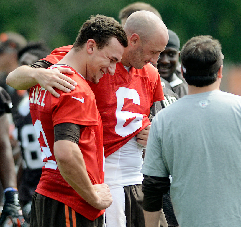 . Duncan Scott/DScott@News-Herald.com Brian Hoyer puts his arm around Johnny Manziel at the end of practice as the Cleveland Browns opened training camp on July 26 at Browns headquarters in Berea.