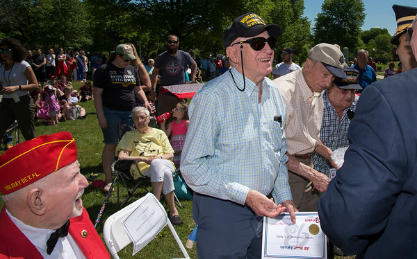 05/27/19 Wesley Bunnell | Staff Bristol held Memorial Day ceremonies on Monday morning ending with a ceremony which presented World War II veterans with All Heart Awards from the city. Navy veteran James Cleveland smiles as he is greeted by the Commissioner Thomas Saadi, Esq. from the Department of Veterans Affairs.