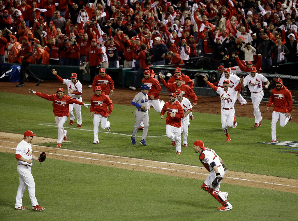 . The St. Louis Cardinals celebrate after Game 6 of the National League baseball championship series against the Los Angeles Dodgers, Friday, Oct. 18, 2013, in St. Louis. The Cardinals won 9-0 to win the series. (AP Photo/Charlie Neibergall)