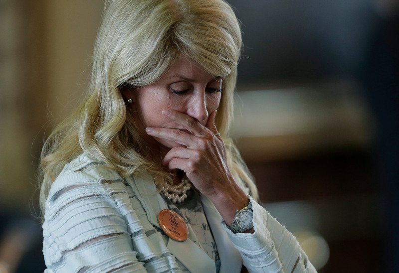 . Sen. Wendy Davis, D-Fort Worth, reacts after she was called for a rules violation during her filibusters of an abortion bill, Tuesday, June 25, 2013, in Austin, Texas. Davis was given a second warning for breaking filibuster rules. (AP Photo/Eric Gay)