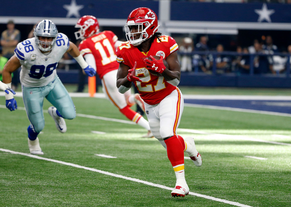 . Kansas City Chiefs\' Kareem Hunt (27) carries the ball against the Dallas Cowboys in the first half of an NFL football game, Sunday, Nov. 5, 2017, in Arlington, Texas. (AP Photo/Michael Ainsworth)