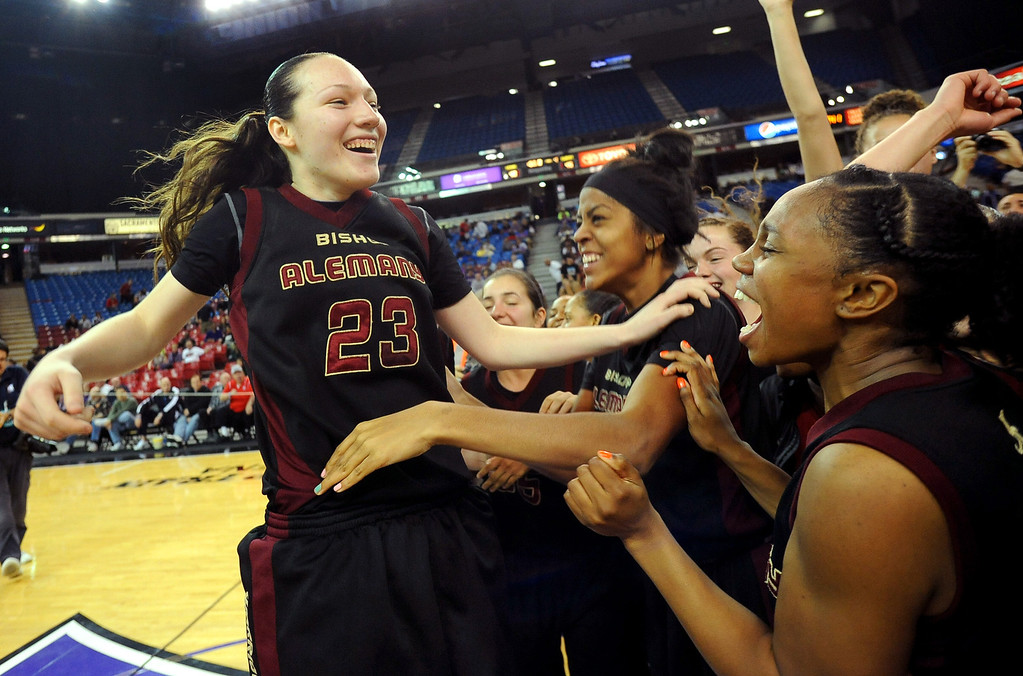 . Alemany High School\'s Leslie Lopez-Wood celebrates after the final buzzer sounds against Sacred Heart Cathedral during the Div III 2013 CIF State Basketball Championship game at the Sleep Train Arena, in Sacramento, Ca March 22, 2013.(Andy Holzman/Los Angeles Daily News)