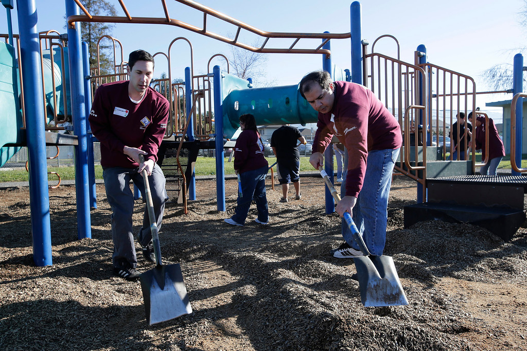 . Kaiser Permanente volunteers, Matthew Seeberger and Tarun Bajaj (l to r) clean up a playground at Ryan Elementary School during a Dr. Martin Luther King Jr. day-of-service activity in San Jose, Calif. on Monday, January 21, 2013.   (Gary Reyes/ Staff)