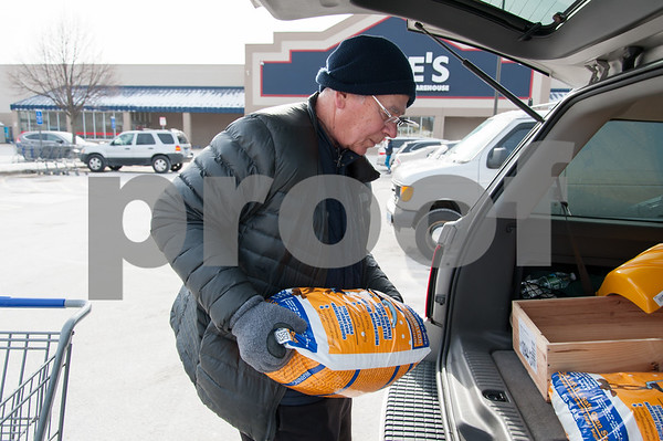 01/03/18 Wesley Bunnell | Staff Jim Rossetti loads his car with ice melt and other winter storm supplies on Wednesday afternoon in Plainville.