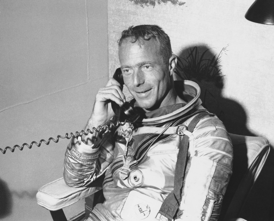 . Astronaut Scott Carpenter talks by phone to President Kennedy from the carrier following rescue in Atlantic, May 24, 1962. (AP Photo)