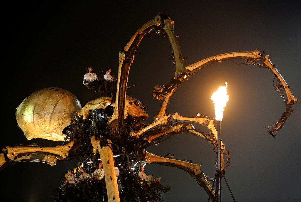 . French production company La Machine\'s mechanical spider also known as La Princesse appears during a performance held in front of the Bird\'s Nest Stadium in Beijing, China, Sunday, Oct. 19, 2014. The performance, which attended by French Foreign Minister Laurent Fabius and his Chinese counterpart Wang Yi, mark the climax of celebrations for the 50th anniversary of Sino-French diplomatic relations. (AP Photo/Andy Wong)