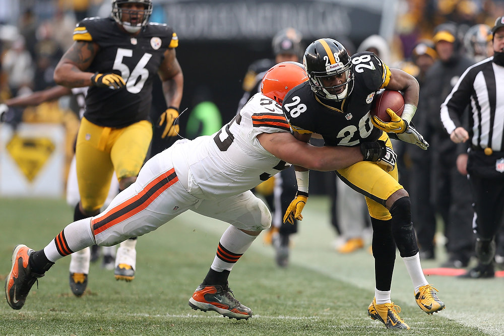 Description of . Cortez Allen #28 of the Pittsburgh Steelers is tackled by Alex Mack #55 of the Cleveland Browns after returning a fumble during the game at Heinz Field on December 30, 2012 in Pittsburgh, Pennsylvania.  (Photo by Karl Walter/Getty Images)