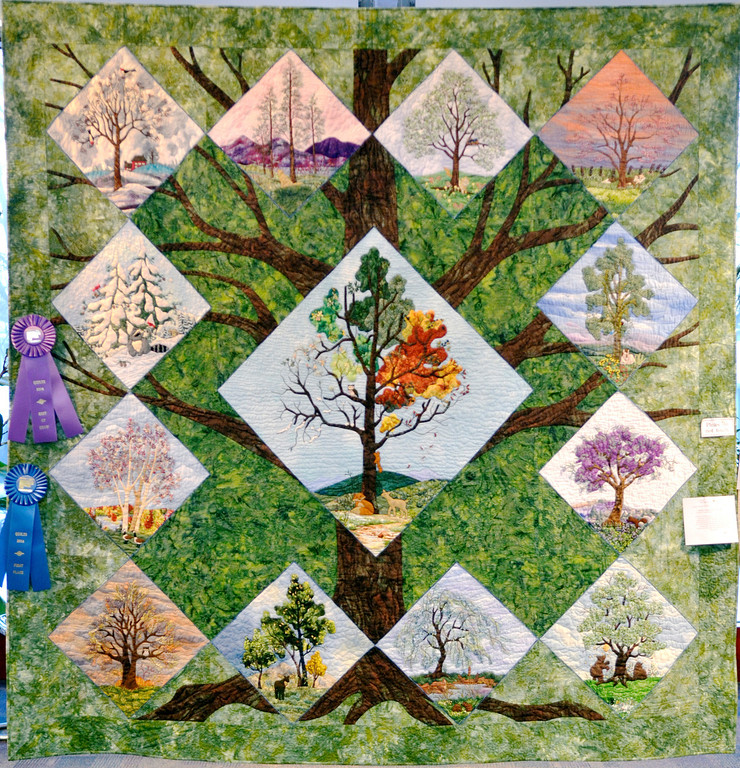 ". Jeff Forman/JForman@News-Herald.com ""For the Love of Trees,\"" by Shirley Tchou, of Pepper Pike, received Best of Show honors in the 23rd Annual Quilts 2014 show at Lake Metoparks Farmpark."
