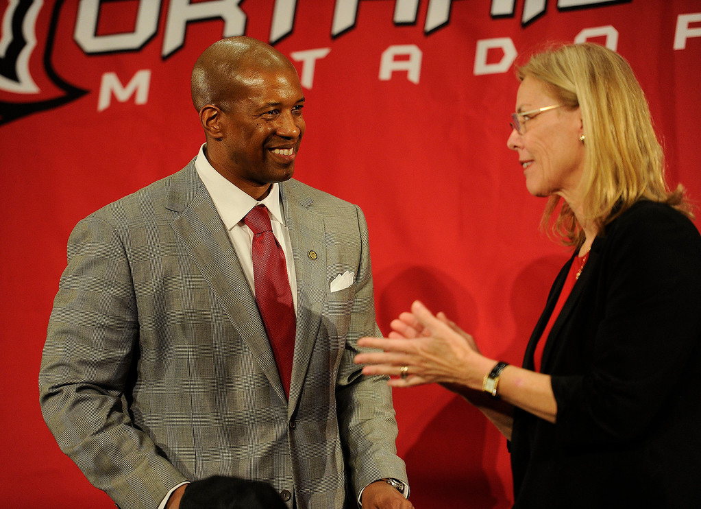 . Brandon Martin smiles as CSUN President Dianne F. Harrison  applauds during a press conference at the Northridge university Monday, February 25, 2013. Martin, a former basketball player and senior associate athletic director at USC was named CSUN\'s new athletic director. ( Hans Gutknecht/Staff Photographer)