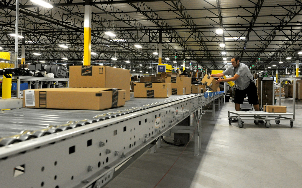 . The Amazon Fulfillment Center in San Bernardino, CA., opened up a year ago with only half of the facility operating for business, now with the the million-square-foot center complete they will host a grand opening on Tuesday, with Gov. Jerry Brown in attendance.  This distribution center has been celebrated in San Bernardino and at the state level as an example of job creation and growth. (John Valenzuela/Staff Photographer)