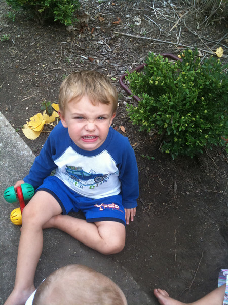 Owen.  (Grandma should know better than to tell him to smile.)