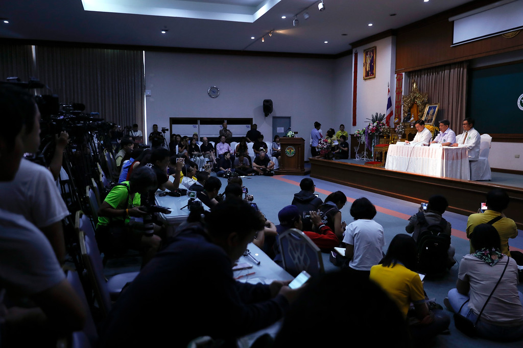 . Jesada Chokdumrongsuk, second from right, deputy director-general of the Public Health Ministry, speaks during a press conference at a hospital in Chiang Rai province, northern Thailand, Tuesday, July 10, 2018. Thai health official says rescued boys will be staying in hospital at least seven days. The Thai public health official said the eight boys rescued from a flooded cave in northern Thailand are in �high spirits� and have strong immune systems because they are soccer players. (AP Photo/Vincent Thian)