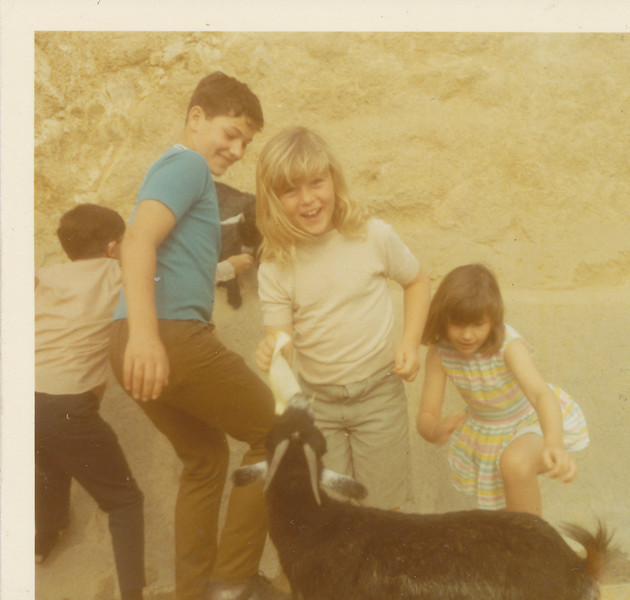 Jeff, Shari & Mona with a goat 1970.jpg