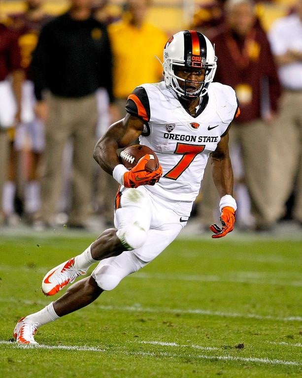 . In this Nov. 16, 2013, file photo, Oregon State wide receiver Brandin Cooks (7) carries the ball during the second half of an NCAA college football game against Arizona State in Tempe, Ariz. Cooks was selected in the first round, 20th overall, by the New Orleans Saints in the NFL draft on Thursday, May 8, 2014. (AP Photo/Rick Scuteri)