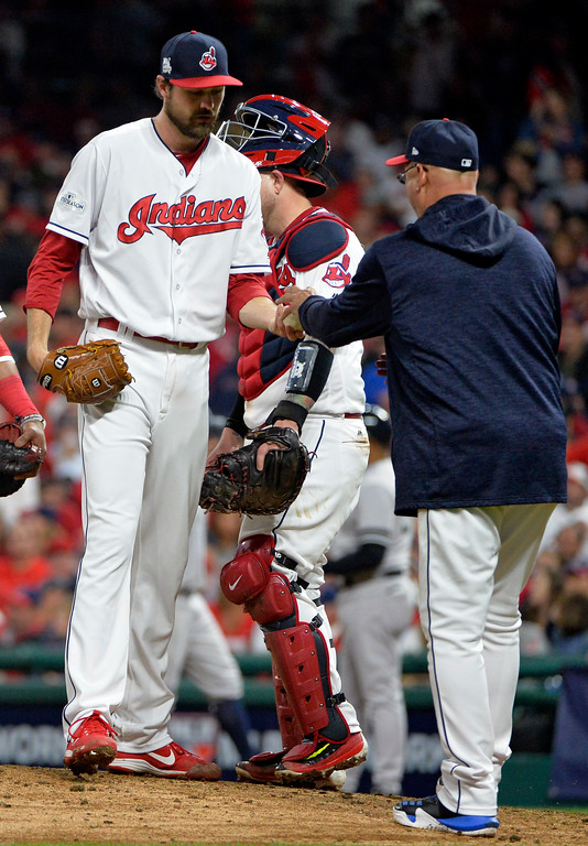 . Cleveland Indians relief pitcher Andrew Miller hands the ball to manager Terry Francona in the eighth inning of Game 1 of baseball\'s American League Division Series against the New York Yankees, Thursday, Oct. 5, 2017, in Cleveland. (AP Photo/Phil Long)