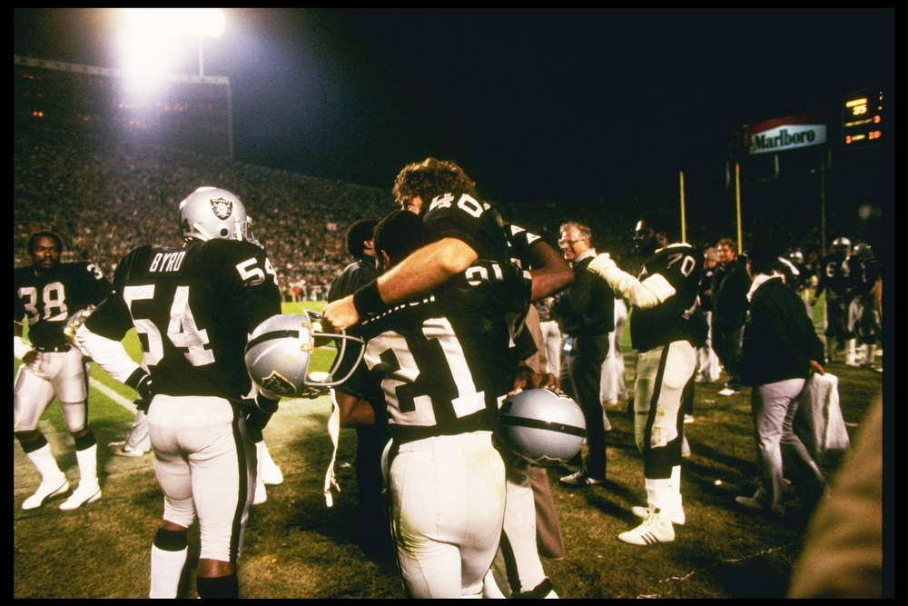 Description of . 22 Jan 1984: The Los Angeles Raiders celebrate after Super Bowl XVIII against the Washington Redskins at Tampa Stadium in Tampa, Florida. The Raiders won the game, 38-9.