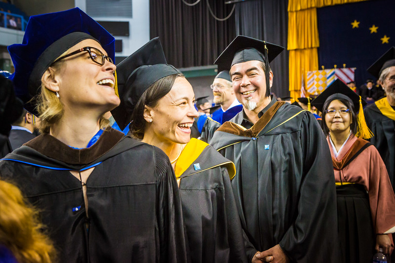 Members of the UAF faculty greet and congratulate students as they process down the aisle flanked by the Class of 2017 during the commencement ceremony Saturday, May 6, at the Carlson Center.