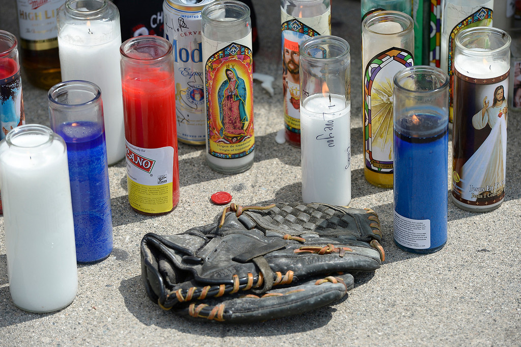 . Students at El Monte High School brought flowers, candles and other items in remembering Adrian Castro, a Senior student who was killed in bus crash in Northern California that took the lives of 10 people. CA. 4/13/2014(Photo by John McCoy / Los Angeles Daily News)