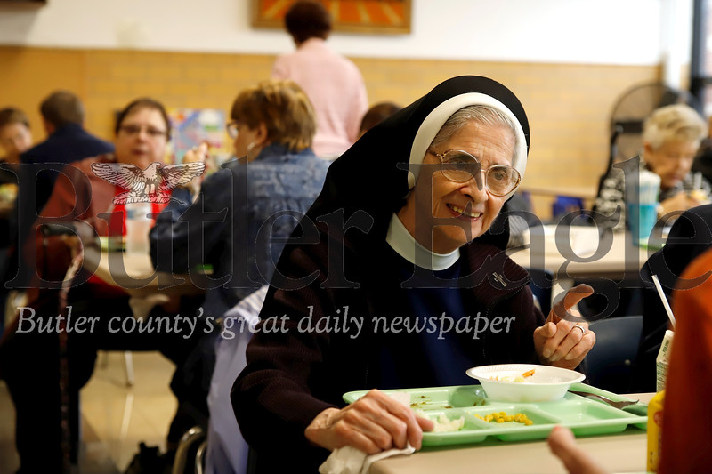 Butler Catholic School's first principal Sister Giuseppe DaBella enjoys lunch with alumni and former employees during the school's 50th anniversary celebration Saturday. Seb Foltz/Butler Eagle