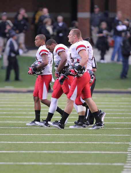 Team captians, Lyndrez Leslie, 2, James Perry III, 17, Marty Patterson, 39, and Zach Welch, 72, walk out for the coin toss.