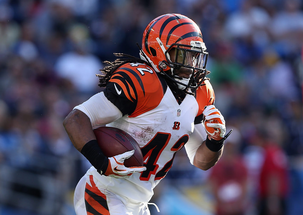 Description of . Running back BenJarvus Green-Ellis #42 of the Cincinnati Bengals carries the ball against the San Diego Chargers in the second half at Qualcomm Stadium on December 2, 2012 in San Diego, California.  (Photo by Jeff Gross/Getty Images)