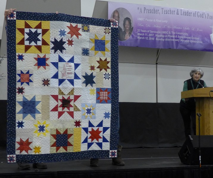 Jean Carlson told us about this quilt.  Pattern is Hero's Tribute from Love of Quilting.  Made by Scrap Fever small group.  Sue Ann Cole embroidered the center block.  Quilted by John Putnam, bound by Louise Mueller.  Will be donated to Quilt of Valor Foundation.