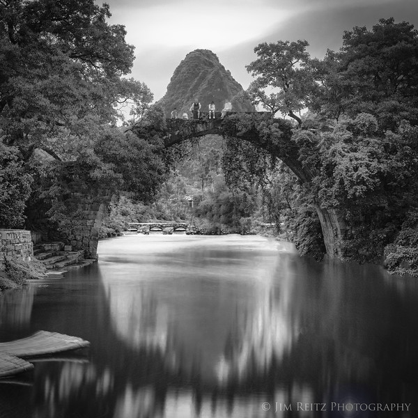 A beautiful old stone arch bridge in rural Yangshuo County, China - built in the Ming Dynasty around 1412 A.D.