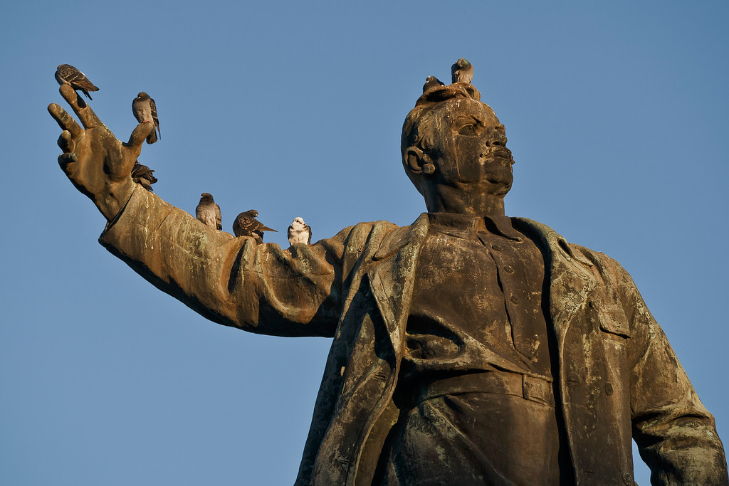 . Pigeons sit on the statue of Russian revolutionary Fyodor Sergeyev, known as Comrade Artyom, in Artemivsk, Ukraine, Wednesday, Feb. 18, 2015. After weeks of relentless fighting, the embattled Ukrainian rail hub of Debaltseve fell Wednesday to Russia-backed separatists, who hoisted a flag in triumph over the town. The Ukrainian president confirmed that he had ordered troops to pull out and the rebels reported taking hundreds of soldiers captive. (AP Photo/Vadim Ghirda)