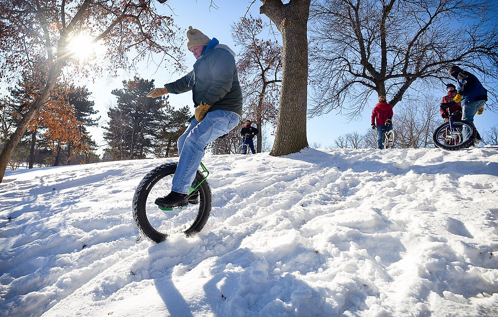 """. Tim Lee of Eagan balances his way down. \""""Every year around New Year\'s Day we do a lap around Como Lake,\"""" said Lee. \""""Today we ended up doing two laps.\""""  (Pioneer Press: Ben Garvin)"""