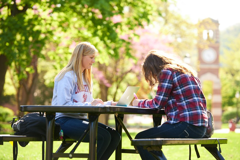 Activity; Studying; Buildings; Clock Hoeschler Tower; Location; Outside; People; Student Students; Woman Women; Spring; May; Time/Weather; snowy; Type of Photography; Candid; Lifestyle; UWL UW-L UW-La Crosse University of Wisconsin-La Crosse; Katie Eisenhauer; Emma Hermes