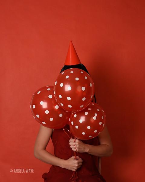 Red Birthday Girl Holding Balloons