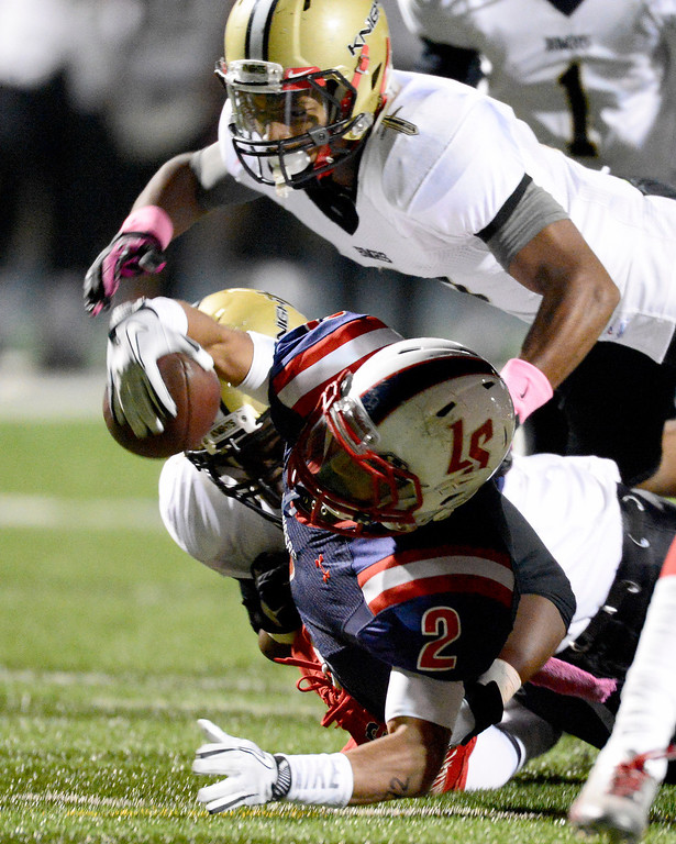 . La Salle\'s Bryce Harvey (2) is tackled by gains yards as Bishop Montgomery during the second quarter in Friday night\'s football game at La Salle High School in Pasadena, October 25, 2013.  (Photo by Sarah Reingewirtz/Pasadena Star-News)