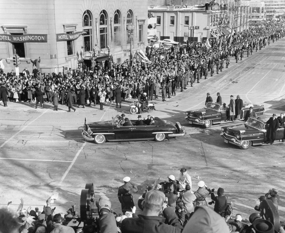 . Kennedy and the first lady are driven through the crowded streets on the day of his inauguration in January 1961.  Photo by Keystone/Getty Images