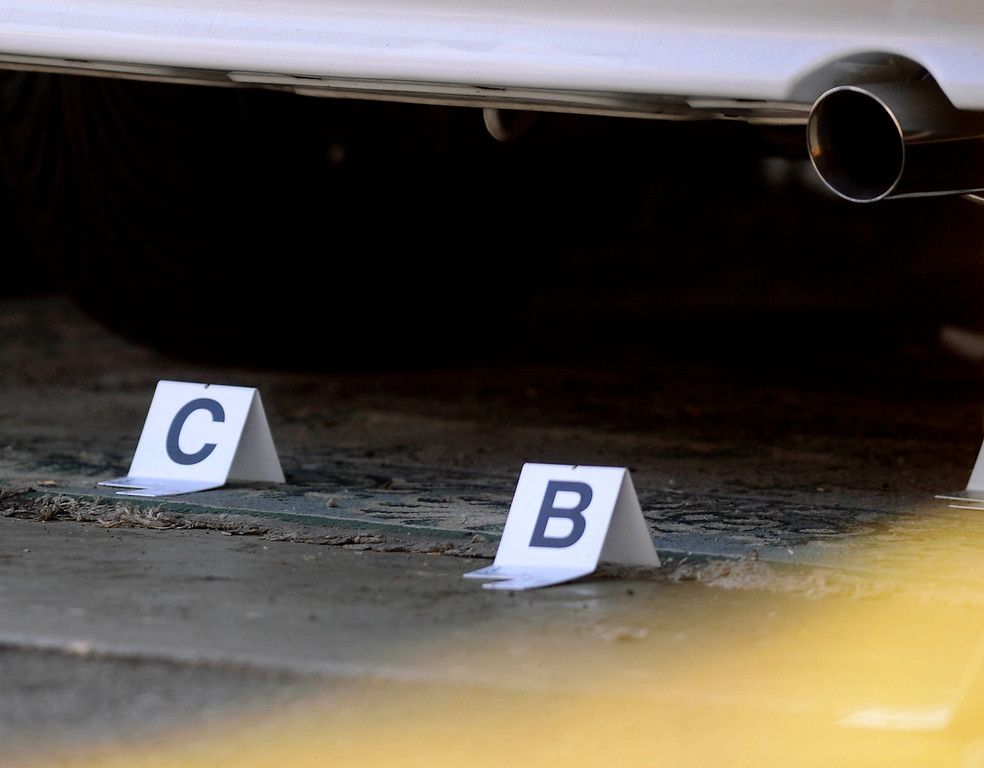 . Evidence markers were visible as the Pomona Police investigated a double-shooting along the 300 block of Orchid Lane in Pomona August 11, 2013.  GABRIEL LUIS ACOSTA/STAFF PHOTOGRAPHER.