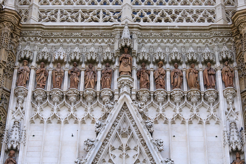 Seville cathedral sculptures on outside of building.
