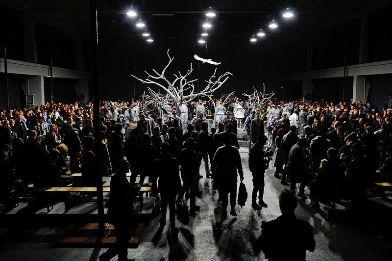 . Spectators watch American fashion designer Thom Browne\'s men\'s Fall-Winter 2014-2015 fashion collection, presented Sunday, Jan. 19, 2014 in Paris. (AP Photo/Zacharie Scheurer)